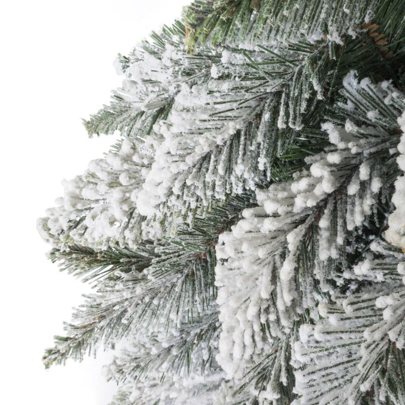 Albero di Natale artificiale abete su tronco con neve